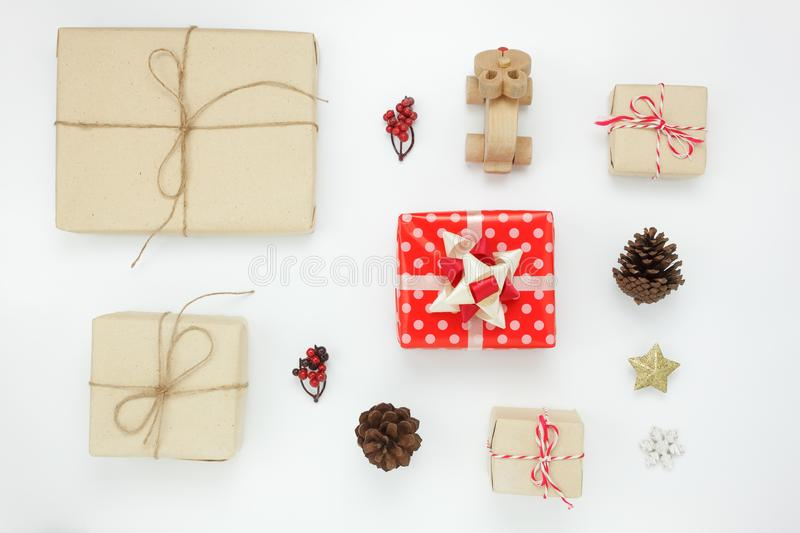Flat lay of object for merry Christmas and Happy new year concept. Essential items on the modern white background at home office desk.Mix gifts box and stock image