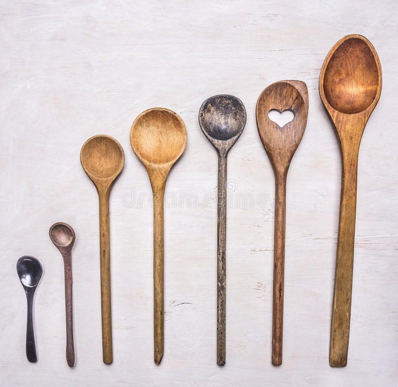 Flat lay of old wooden cooking spoons wooden rustic background top view close up royalty free stock images