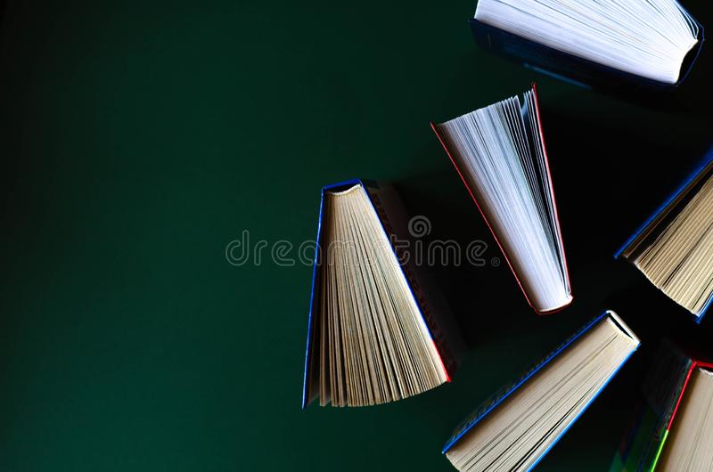 Flat lay of the opened books on the background of khaki stock photos