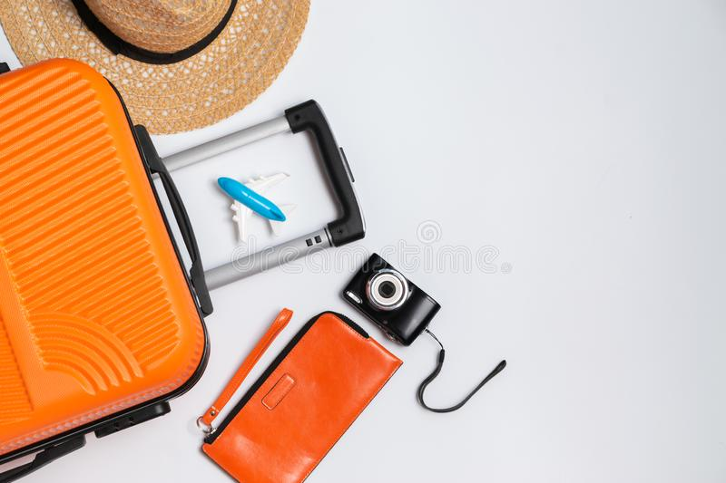 Flat lay orange suitcase with traveler accessories on white background. travel, summer and holiday concept.  stock photos