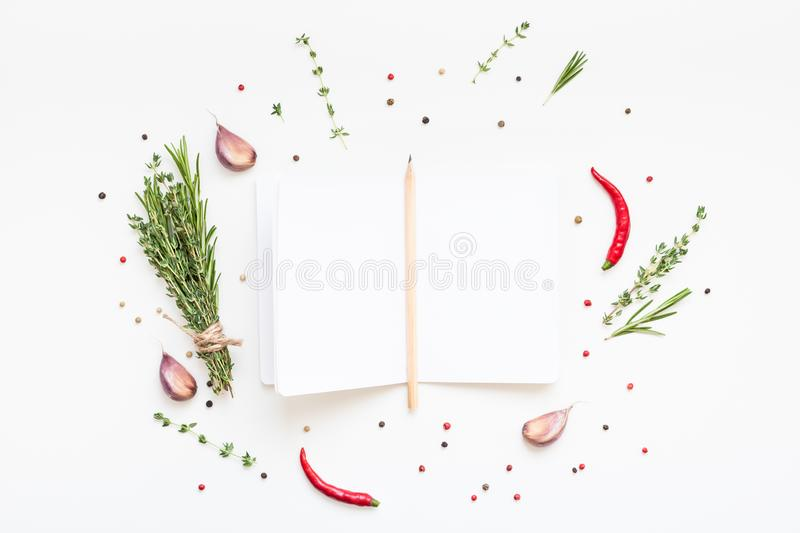Blank notepad pages with greens herbs and spices. Flat lay overhead view blank notebook pages mockup text space invitation card on white background with greens stock photo