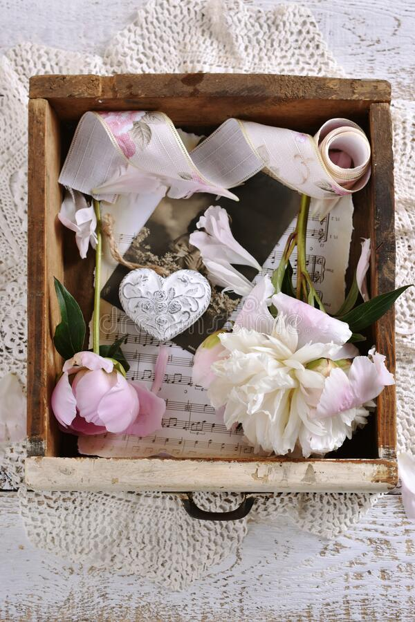 Flat lay with peonies in vintage wooden drawer stock photography