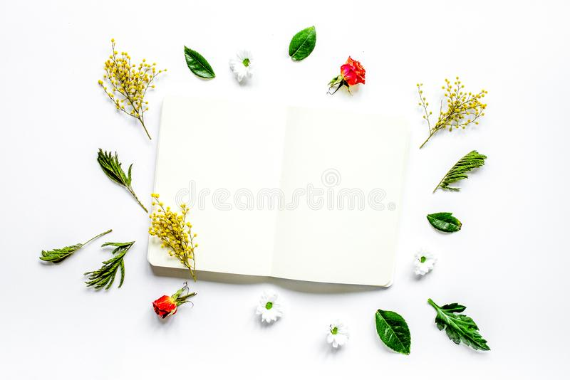 Flat lay with petals and copybook top view mock up stock photo