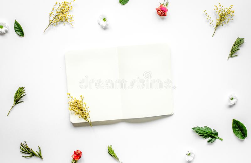 Flat lay with petals and copybook top view mock up royalty free stock photo