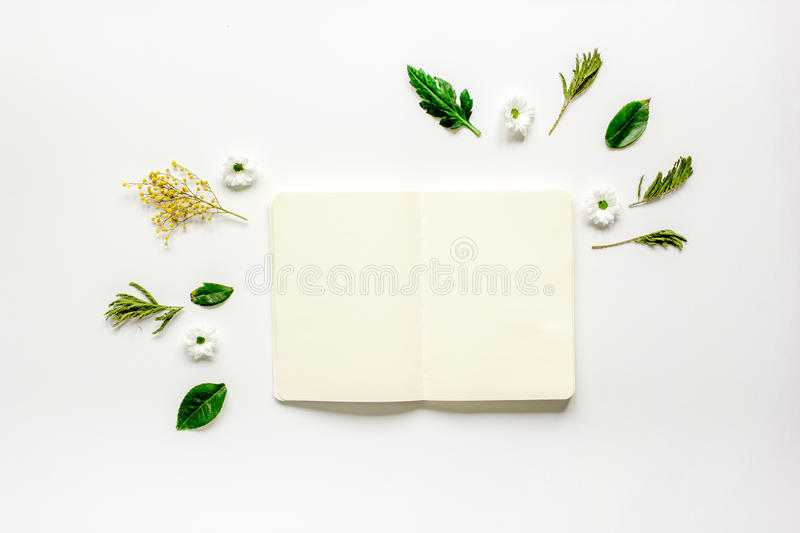 Flat lay with petals and copybook top view mock up stock image