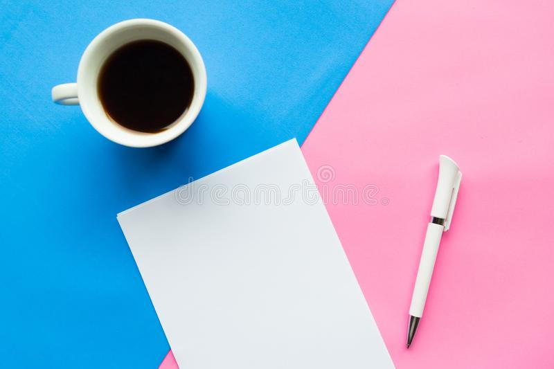 Flat lay photo with coffee cup and white paper blank stock photos