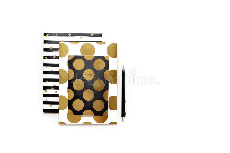 Flat lay photo of minimalistic white office desk with stylish gold notebooks copy space background. Mock up template royalty free stock image