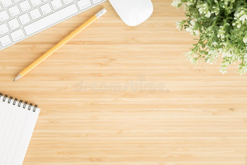 Flat lay photo of office desk with mouse and keyboard ,Top view workpace on bamboo wood table and copy space stock photos