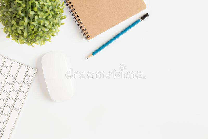 Flat lay photo of office desk with mouse and keyboard White cop. Y space with pencil top view stock photography