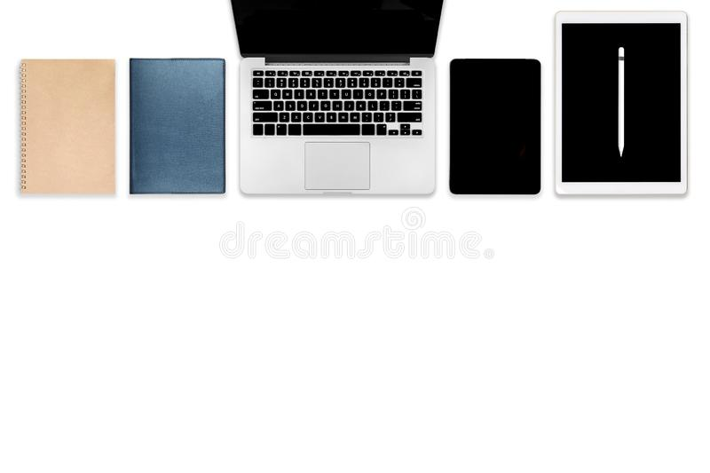 Flat lay photo of office table with laptop computer, digital tablet, mobile phone and accessories. on modern tone background. royalty free stock photography
