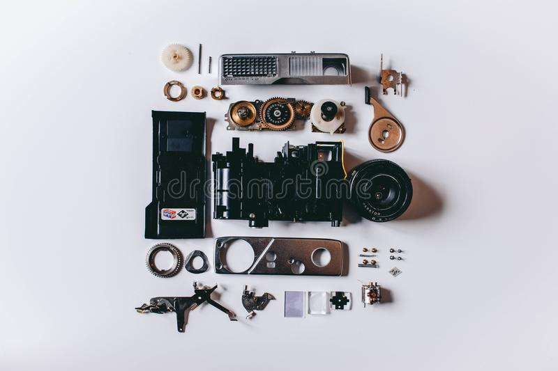 Flat Lay Photography of Black and Gray Components on White Surface royalty free stock images