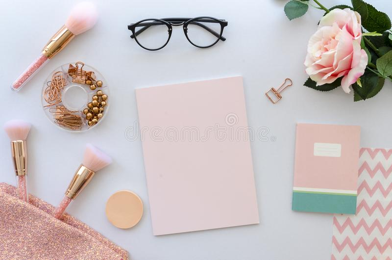 Flat lay pink composition with blank note cosmetics, makeup tools, glasses and rose on white background. beauty, fashion stock photos