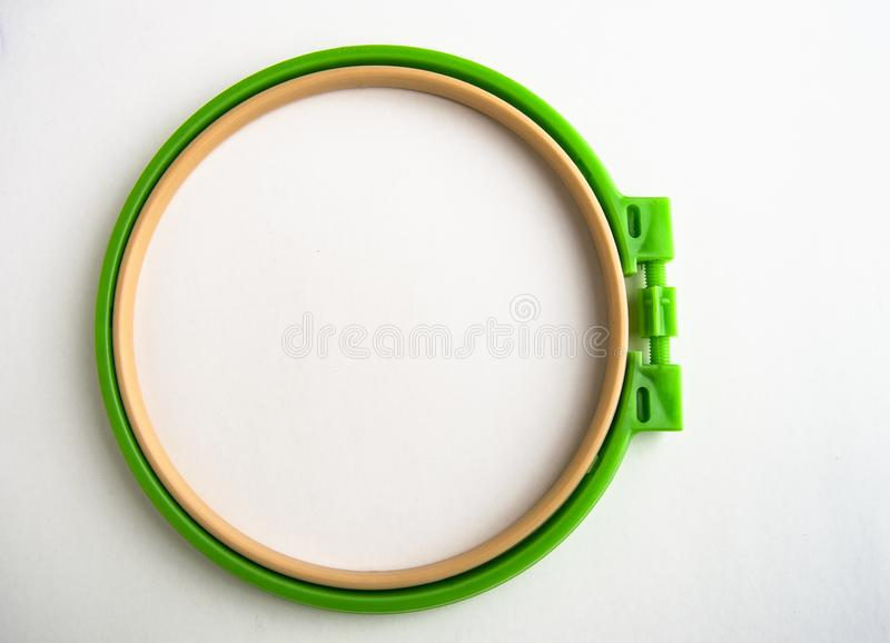Flat lay plastic embroidery Hoop isolated on white background for needlework royalty free stock photos