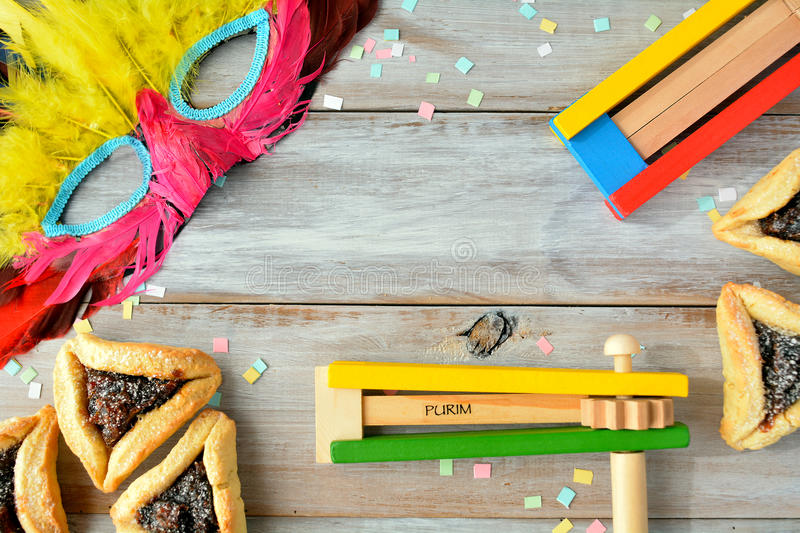 Flat lay of Purim Jewish holiday food and objects royalty free stock images