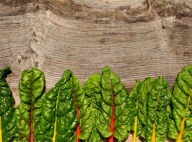 Flat lay rainbow swiss chard healthy diet recipes mock up backg stock images