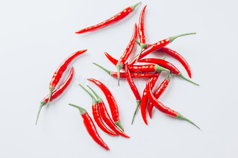Flat lay red chili peppers pattern on white background royalty free stock photos