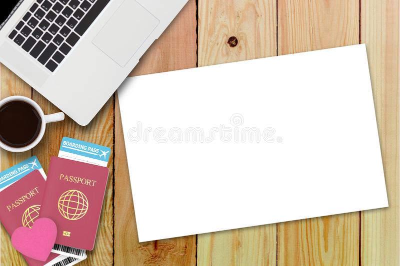 Flat lay of red heart on two passport , coffee , computer laptop royalty free stock image