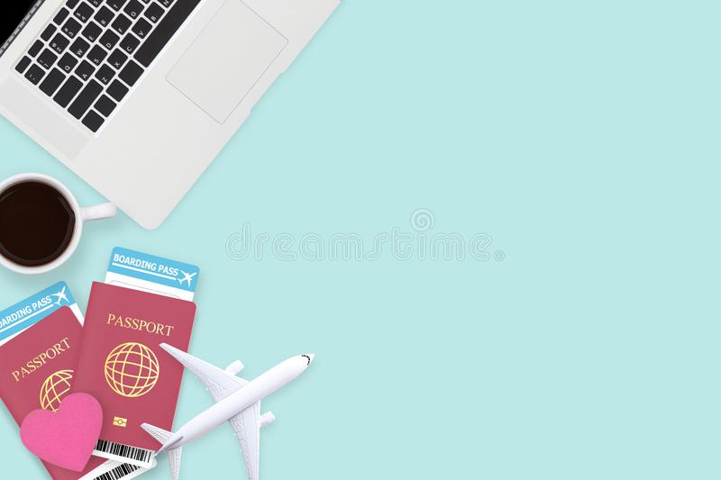 Flat lay of red heart on two passport , coffee , computer laptop royalty free stock images