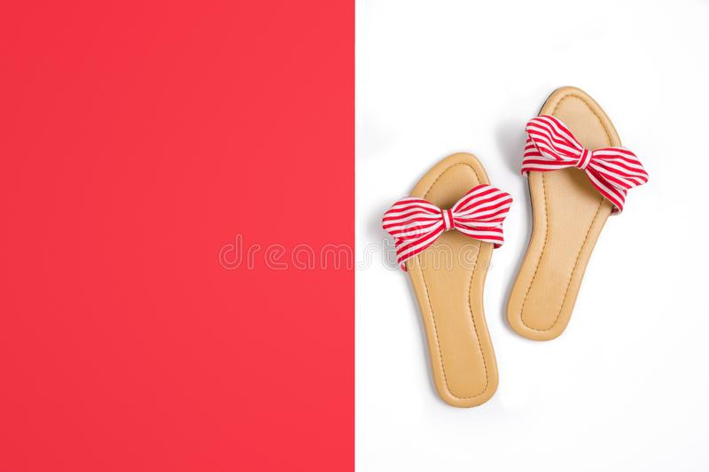 Flat lay red stripy sandals with copy space for text fashion lifestyle background image. Flat lay red stripy sandals with copy space for text fashion lifestyle stock image