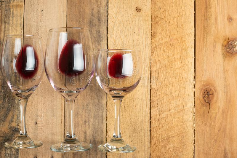 Flat lay red wine in glasses on wooden background with space, Concept of wine distillation, winery, winery, wine bar, party royalty free stock images