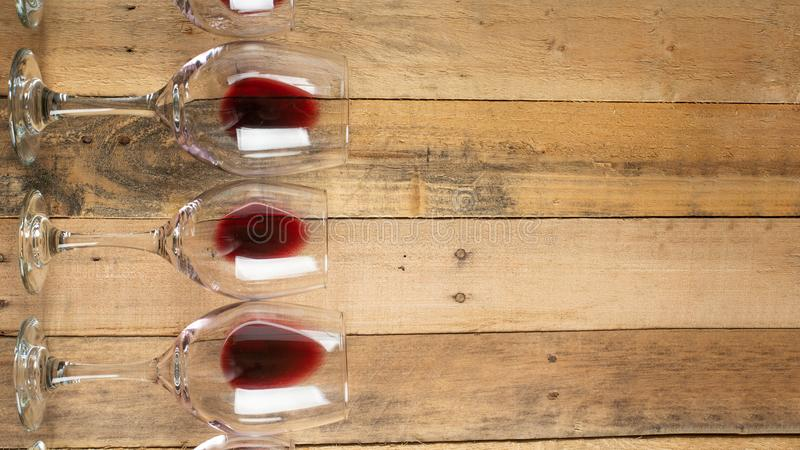 Flat lay red wine in glasses on wooden background with space, Concept of wine distillation, winery, winery, wine bar, party stock image