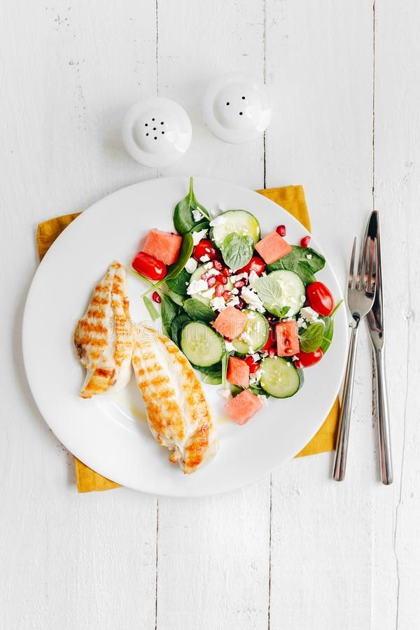 Grilled chicken with salad on plate royalty free stock images