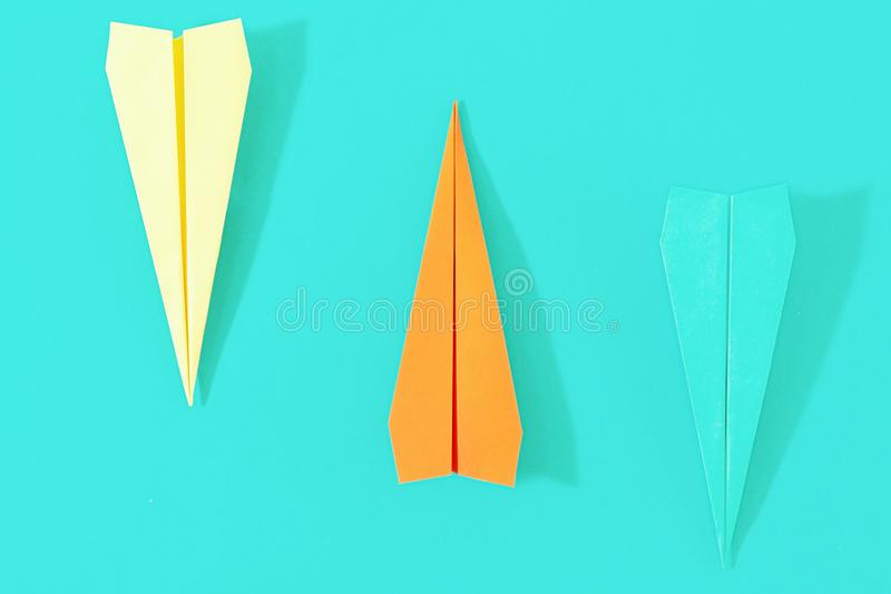 Flat lay set colorful paper plane pastel turquoise background Cr stock photos