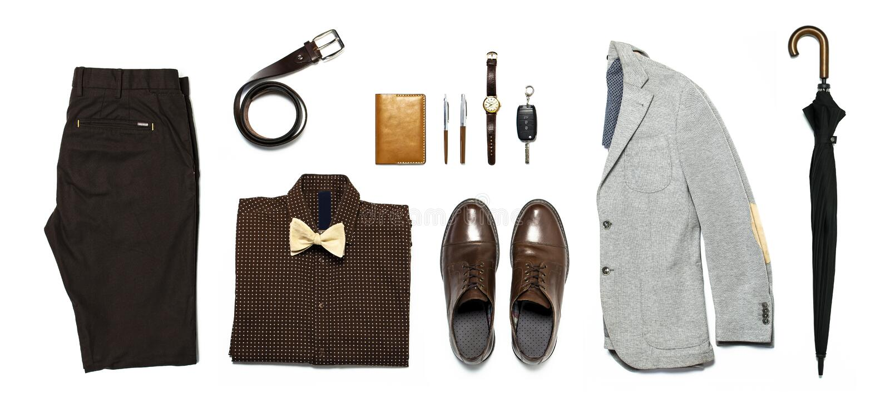 Flat lay set Men`s classic clothing, jacket pants shirt bow tie leather belt shoes wrist watch wallet pens umbrella cane car keys stock photo