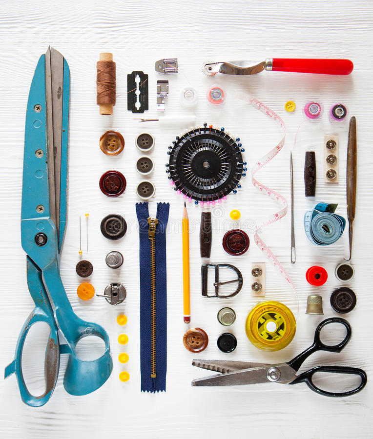 Flat lay of sewing tool and accessories on white wooden background royalty free stock photo