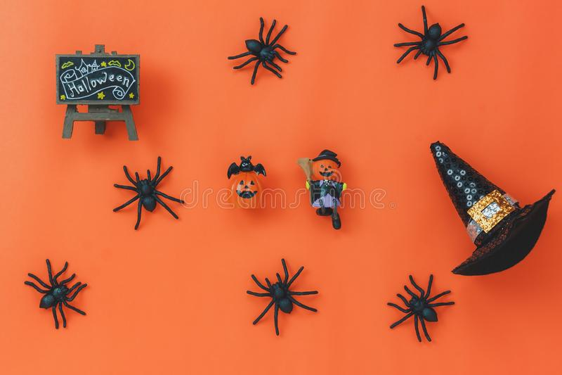 Flat lay of sign Happy Halloween festival background concept. Top of essential object on the modern rustic orange table wood with home decoration.Necessary stock photos