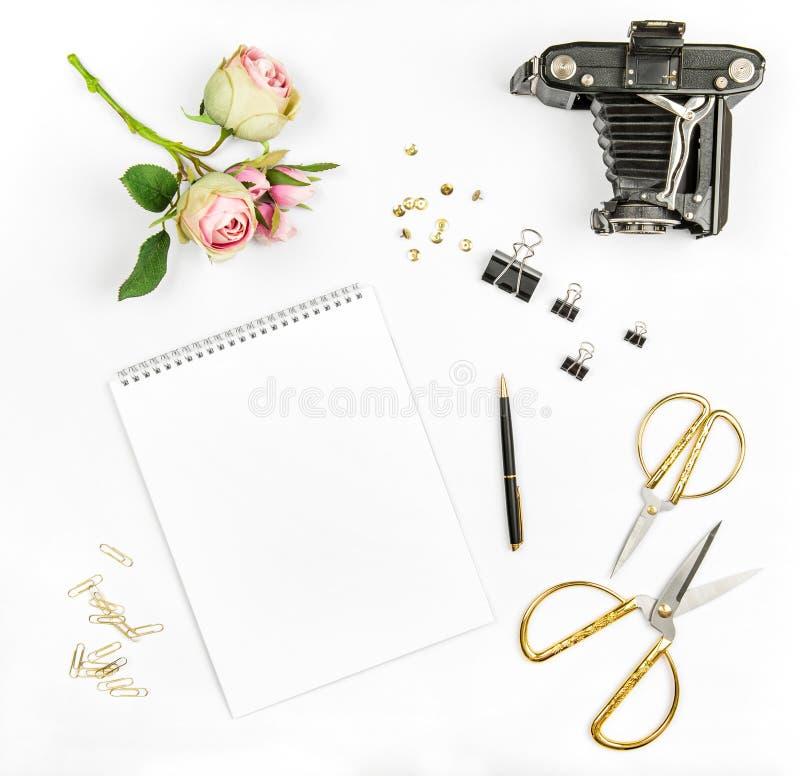 Flat lay sketchbook flowers vintage photo camera scissors stock photos