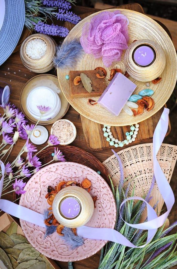 Flat lay spa accessories, handmade artisan soap, fresh flowers, wisp of bast, candles, bath salt. Etc stock photos