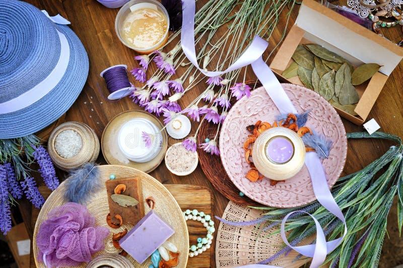 Flat lay spa and fashion accessories, handmade artisan soap, fresh flowers, wisp of bast. Candles, bath salt etc royalty free stock photo