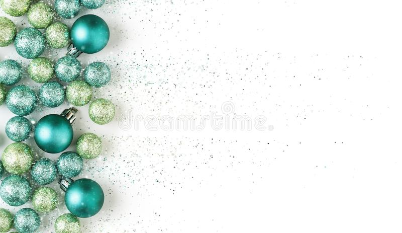 Beautiful, bright, modern, blue and green Christmas holiday ornaments decoration with glitter special effect. stock photo