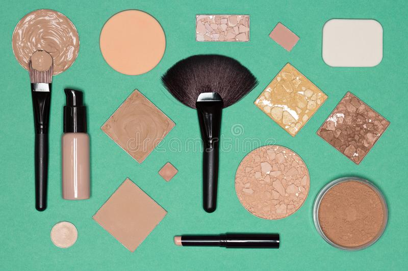 Flat lay still life of foundation makeup products. Corrective makeup set: concealer pencil, primer, liquid and cream foundation, various functional types of stock images