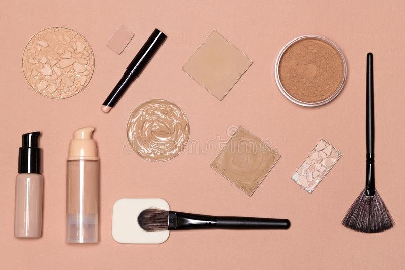 Flat lay still life of foundation makeup products. Set of foundation makeup products: concealer stick, primer, liquid and cream foundation, cosmetic powder with stock image