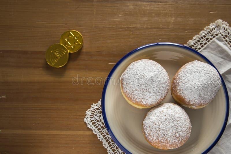 Flat Lay Hanukkah celebration concept image-closeup of donuts a royalty free stock images