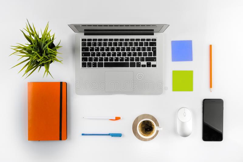 Flat lay styled photo of office desk with laptop, notebook and coffee. Flat lay photo of office desk with laptop, notebook and coffee royalty free stock photo