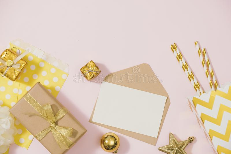 Flat lay stylish set: champagne, gift, christmas balls and golden holiday decoration. Flat lay, top view.  royalty free stock image