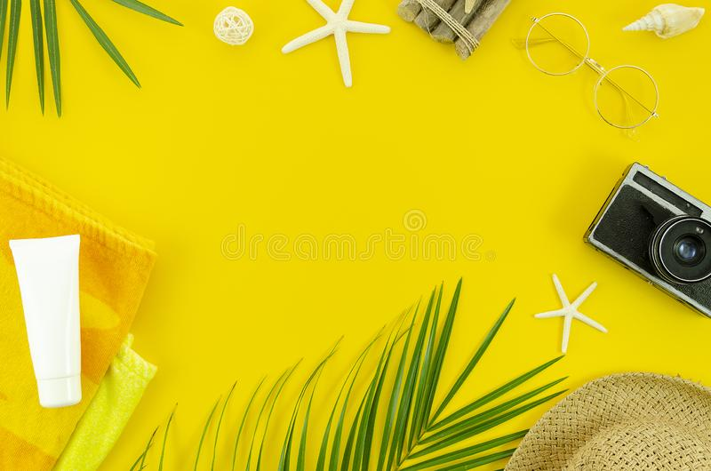 Flat lay summer backgroung with copy space for text banner or lettering. Top view palm tree leaf branch, towel, sunblock stock photo