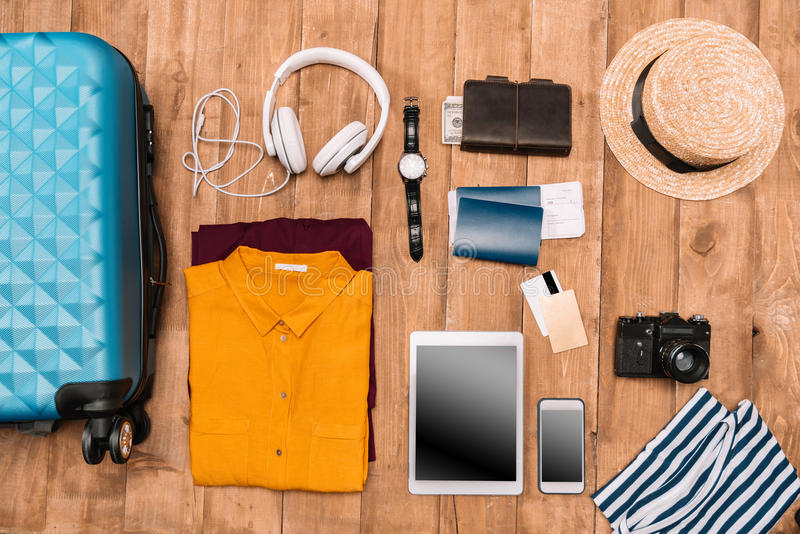 Flat lay of summer vacation things neatly organized on wooden background. Travel concept stock photos