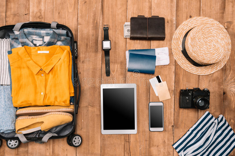 Flat lay of summer vacation things neatly organized on wooden background. Travel concept royalty free stock photo