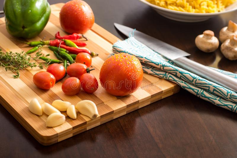 Table top food / cooking stock photo with pasta and ingredients on chopping board. Food concept image with nobody in image stock photo