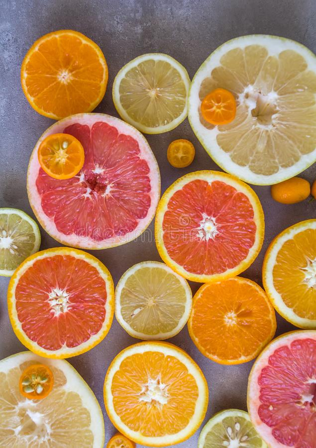 Flat lay top view of beautiful variety of fresh citrus fruits half cut. Oranges, lemons , clementine, red grapefruit. Natural source of vitamins , clean stock images