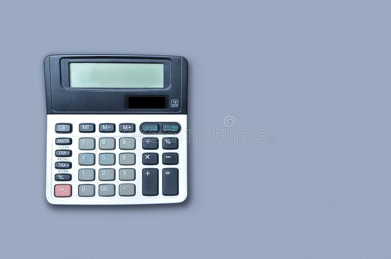 Flat lay or top view of calculator on viollet background paper with blank copy space, math, cost, tax or investment calculation. stock images