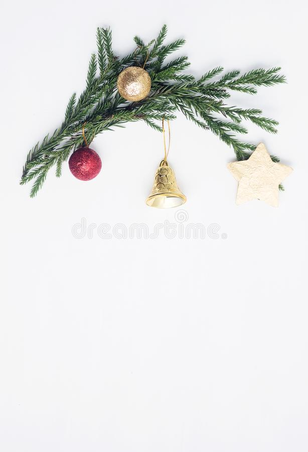 Flat lay top view Christmas border frame made of fir branches, toys and gifts royalty free stock photography