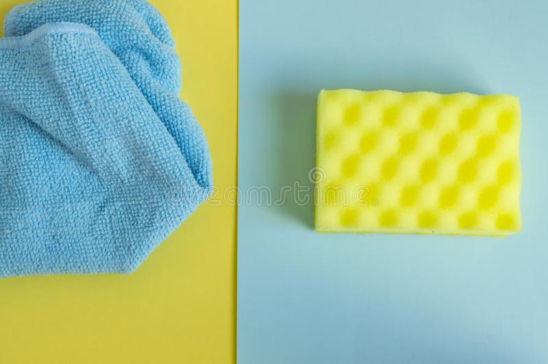 Flat lay, top view. Detergents and cleaners yellow and blue. The concept of cleaning royalty free stock image