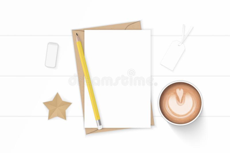 Flat lay top view elegant white composition letter kraft paper envelope coffee pencil star craft and eraser on wooden background. A Flat lay top view elegant royalty free stock images