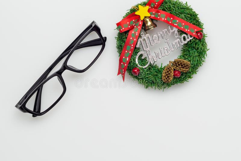 Flat lay top view of eyeglasses and merry christmas sign with copy space. Merry Christmas and Happy new year background concept. Above, blank, business, card stock photos