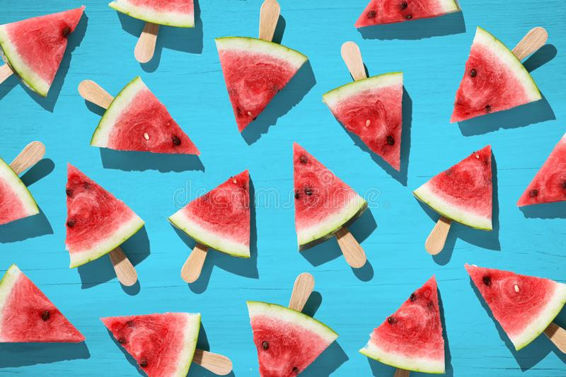 Flat lay top view of fresh watermelon slices on color background. royalty free stock photos